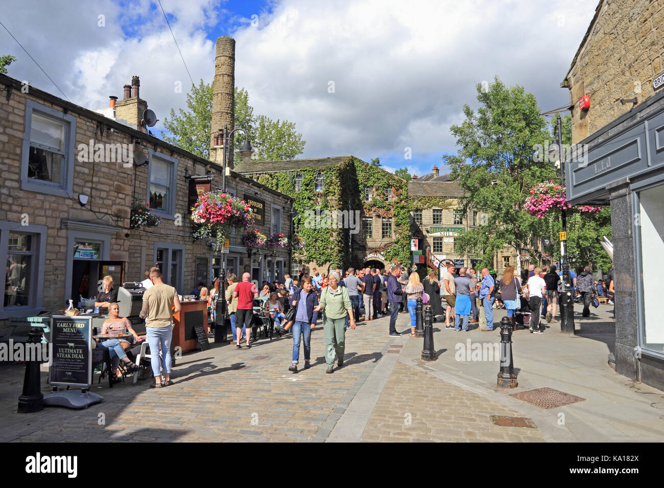 St George's square and Shoulder of Mutton public house with visitors enjoying summer sunshine, Hebden Bridge, - Stock Image