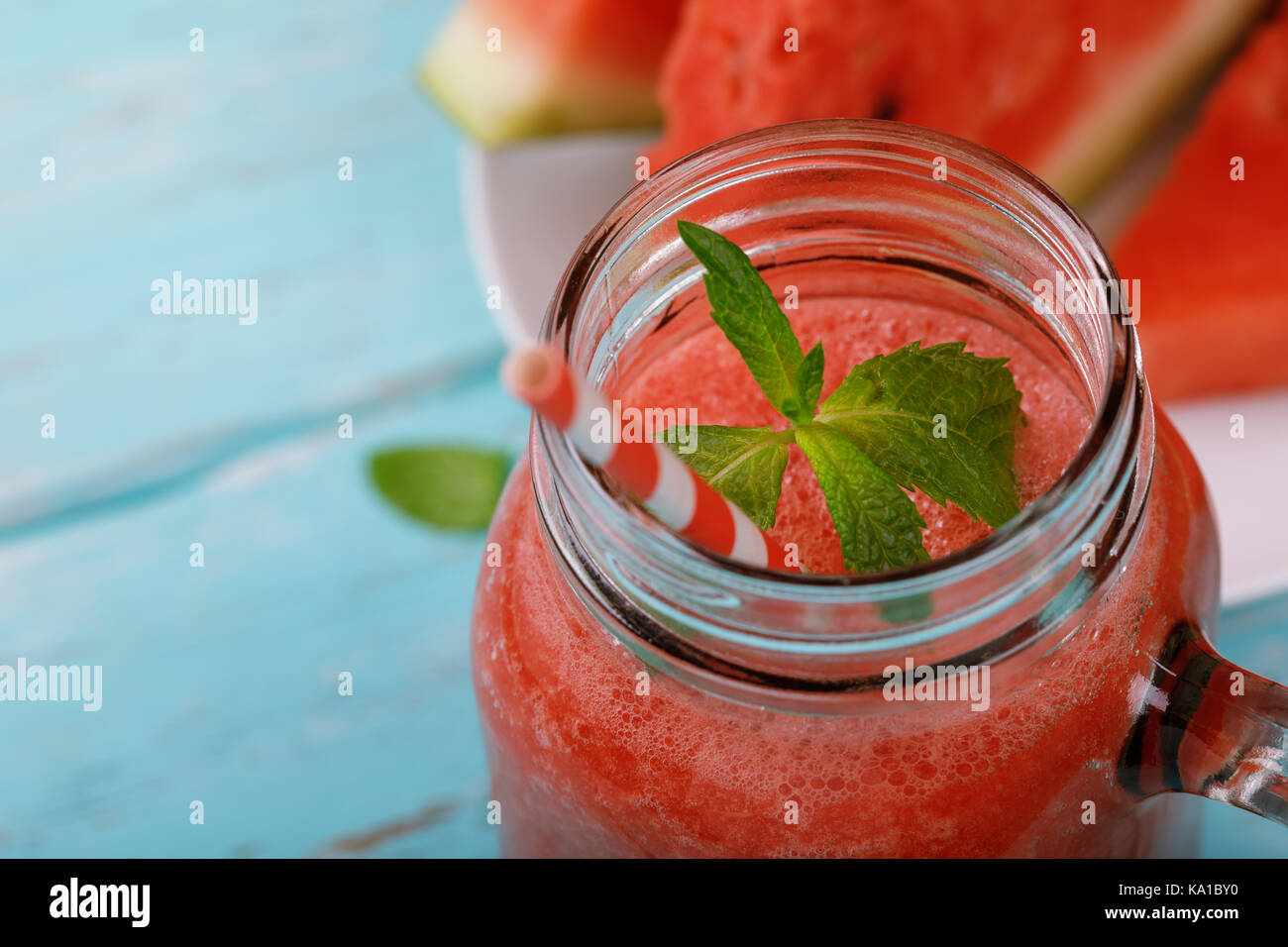Freshly prepared smoothies from watermelon with mint leaves. Space for text - Stock Image