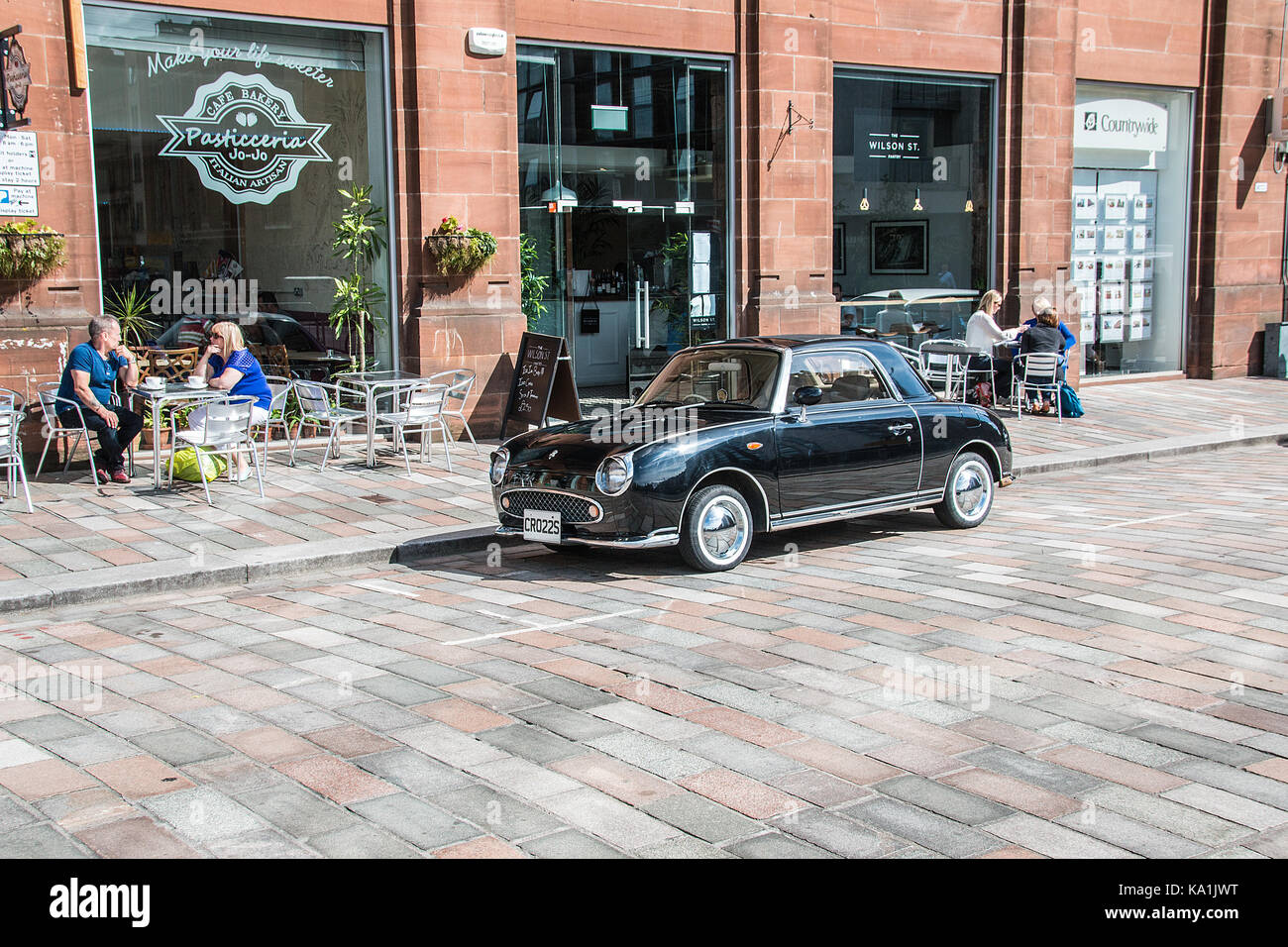 Quiet drinks outside a cafe bar on a summers day in the Merchant city area of Glasgow Scotland 25Aug2014 - Stock Image
