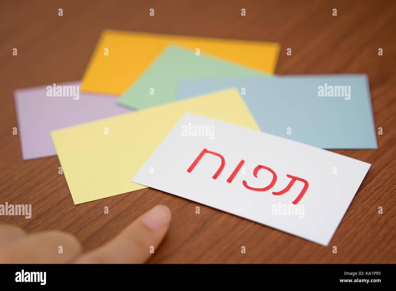 Hebrew; Learning New Language with the Flaish Card (Translation; Apple) - Stock Image