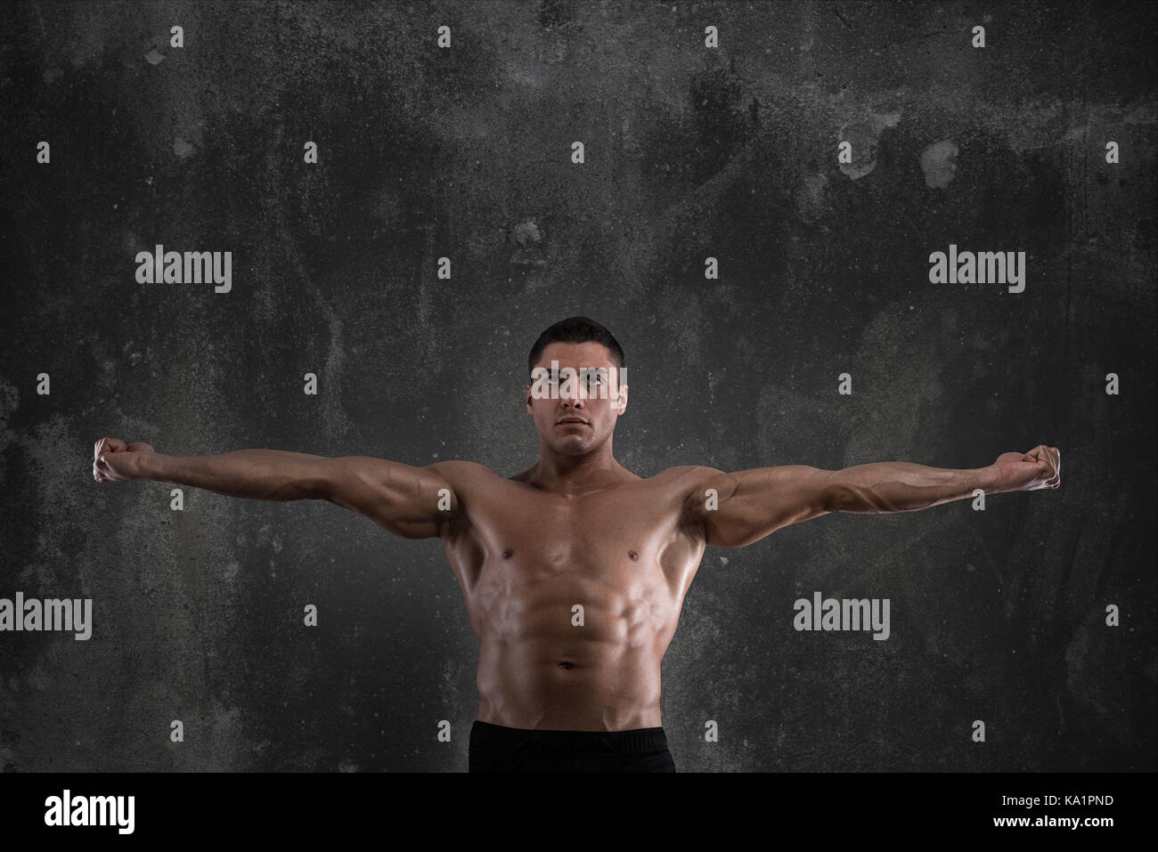 Muscular of a body building trainer - Stock Image