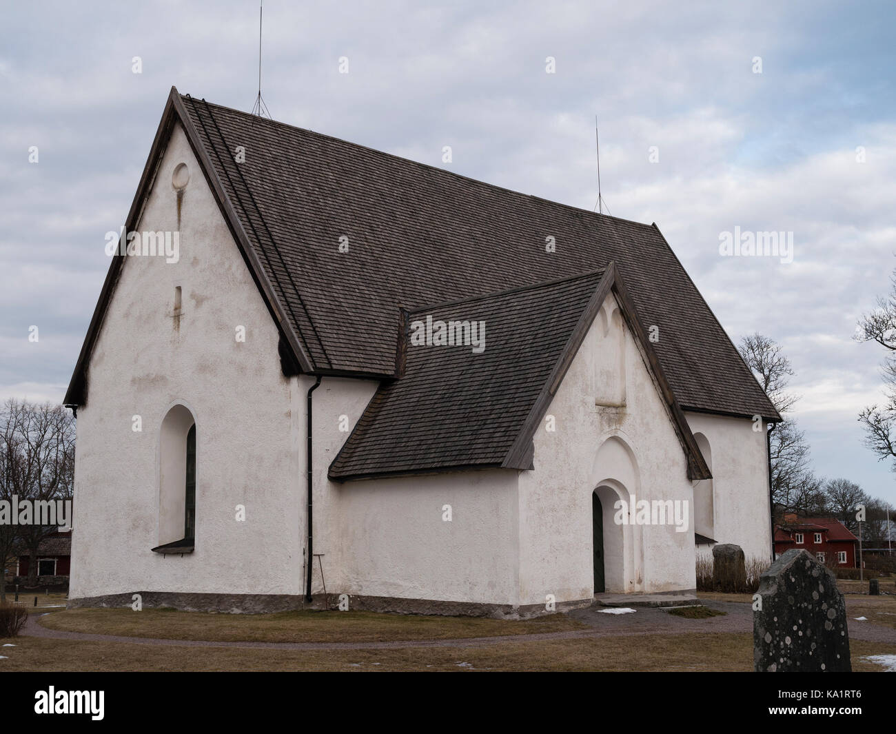 Church of Östuna, outside of Odensala, Knivsta in the municipality of Knivsta, north of Stockholm in Sweden, - Stock Image