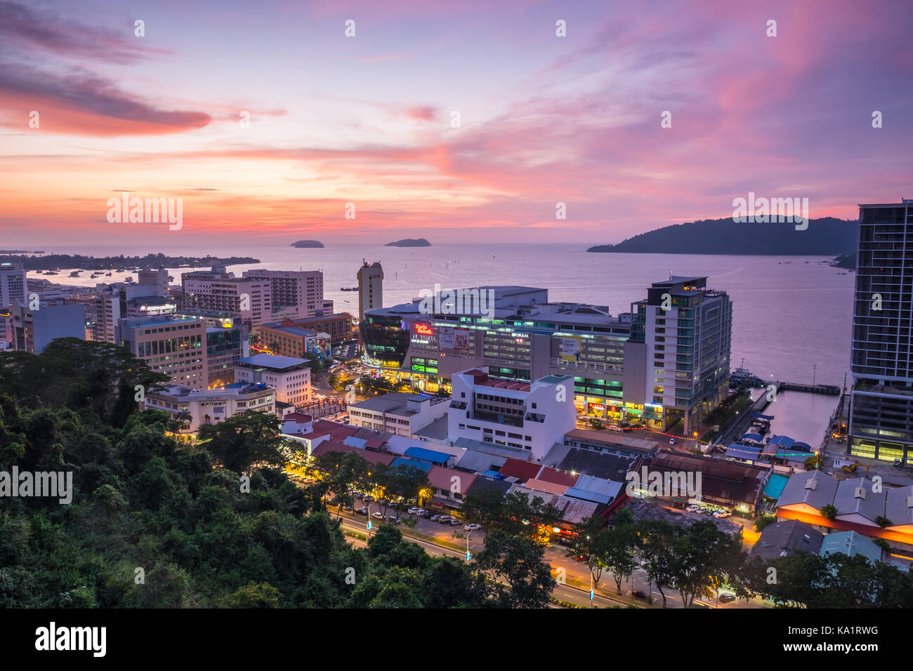 Kota Kinabalu at night with view featuring Suria Sabah and South China Sea Stock Photo