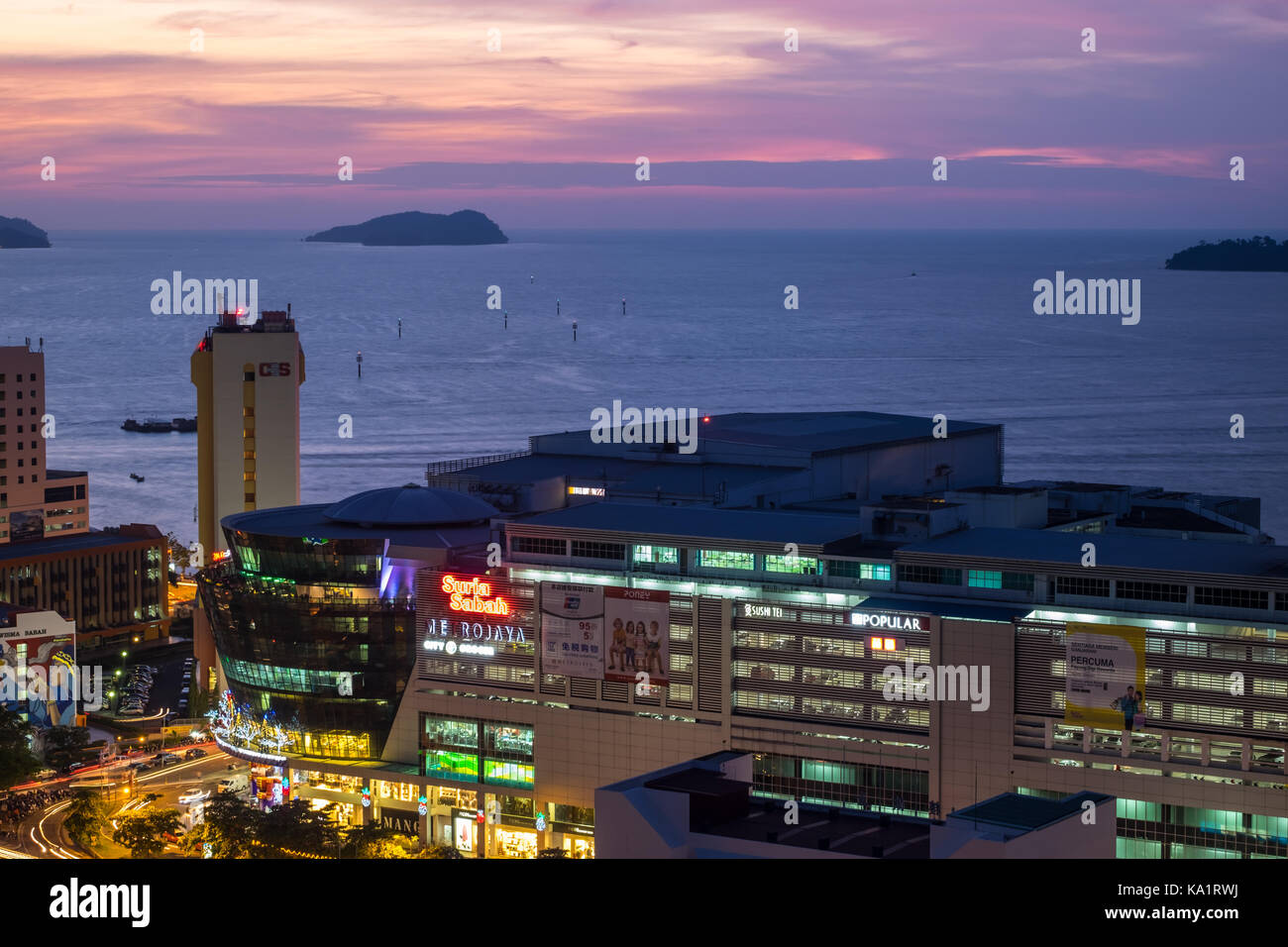 Kota Kinabalu at night with view featuring Suria Sabah and South China Sea - Stock Image