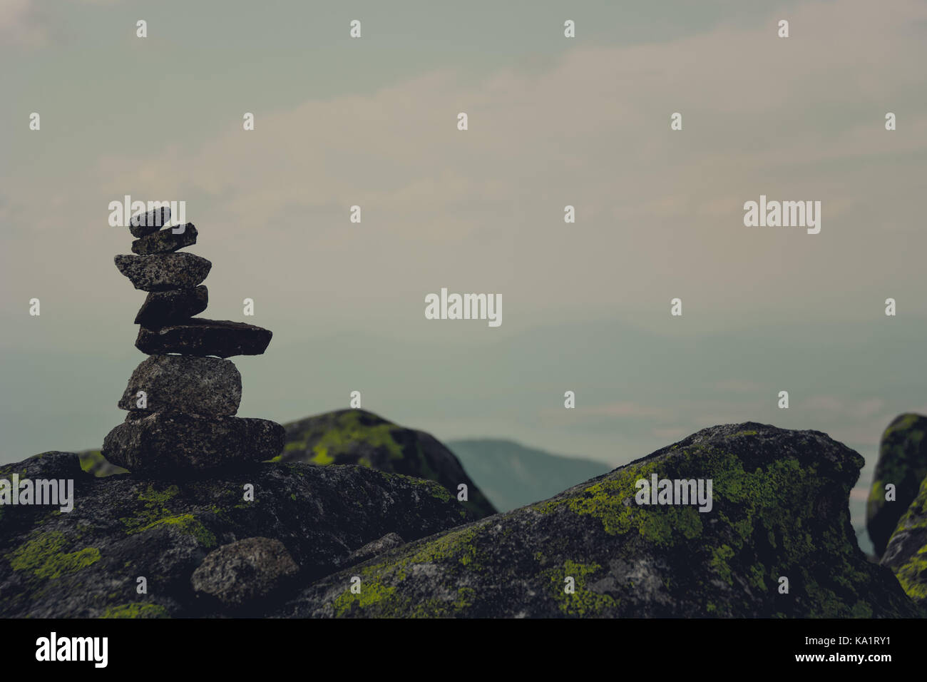 Alone on top of the mountain, allready forgotten by people and time..., only sun and moon knows, who or what has - Stock Image