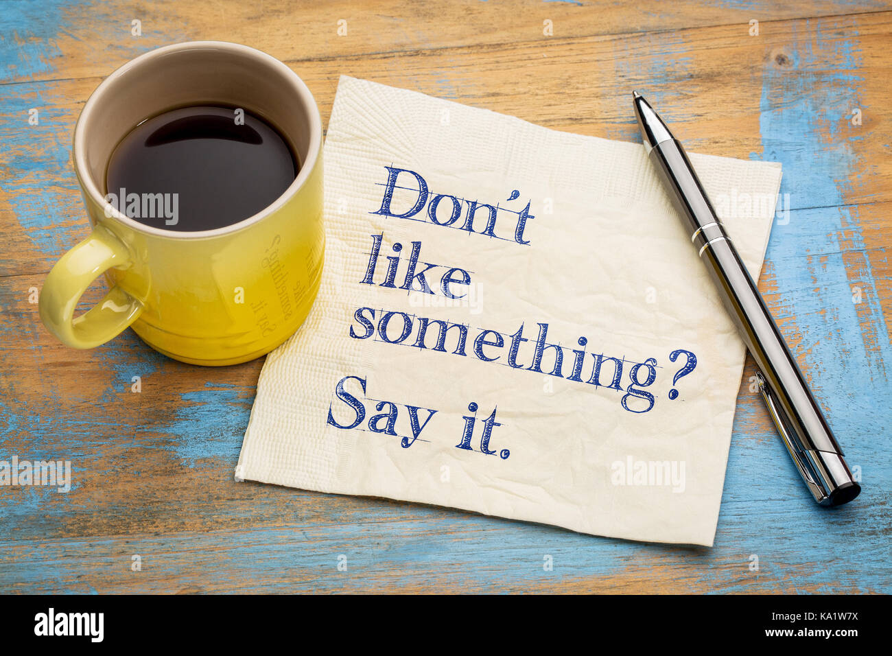 Do not like something? Say it. Handwriting on a napkin with a cup of espresso coffee - Stock Image