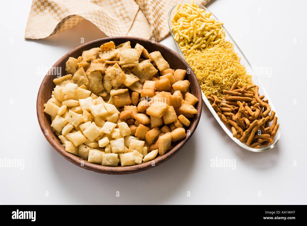 stock photo of Yellow Namkeen sev variety with shakkar para or shankar pale, Shakkarpare, Shakarpali served in white Stock Photo