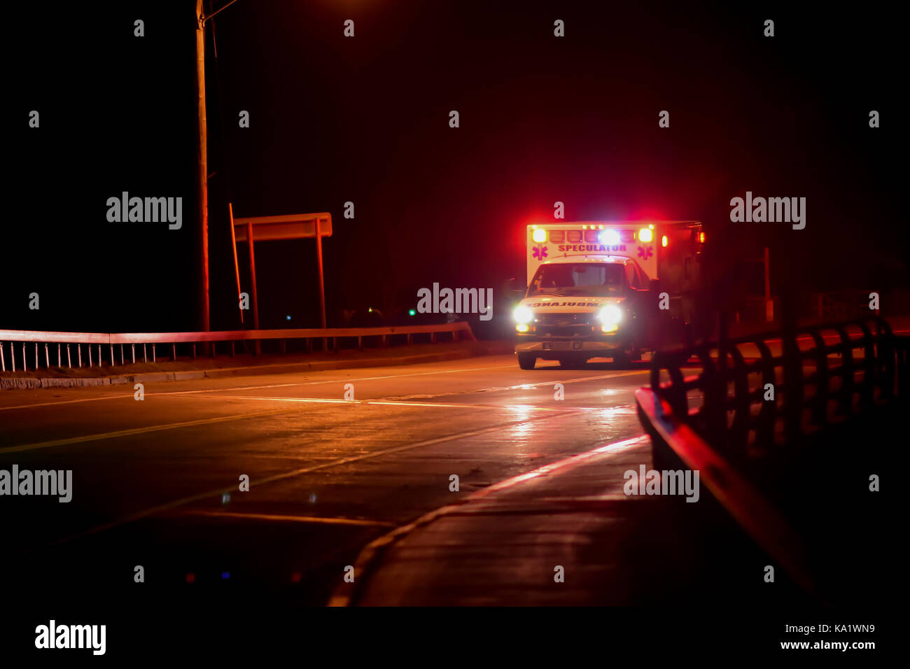 Speculator, NY ambulance racing to a medical emergency at night. - Stock Image