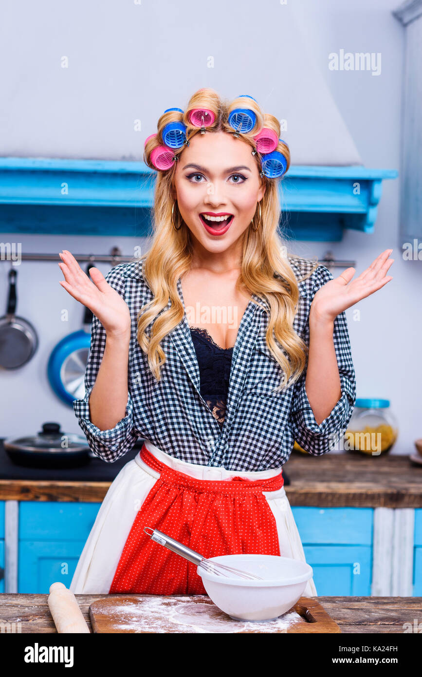 housewife cooking in kitchen - Stock Image