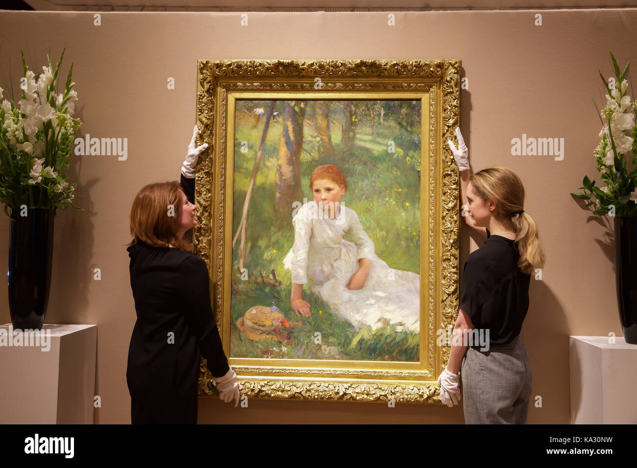 London,UK,25th August 2017,Noon in the Hayfield, by George Clausen, leads the photo call for Bonhams 19th Century Stock Photo