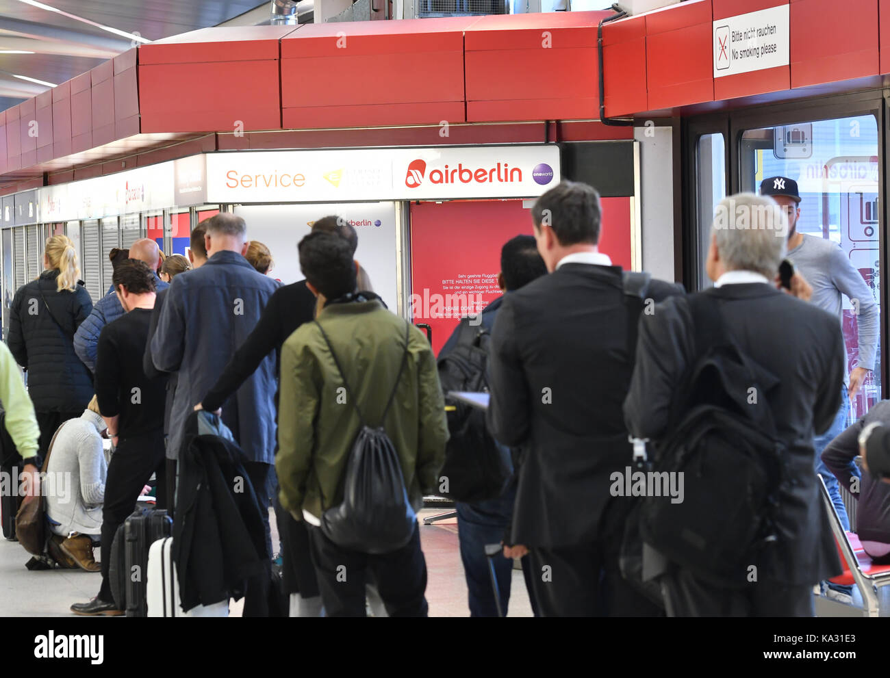 Passengers queue at an Air Berlin terminal in Tegel airport, Germany, 25 September 2017. The company's creditors - Stock Image