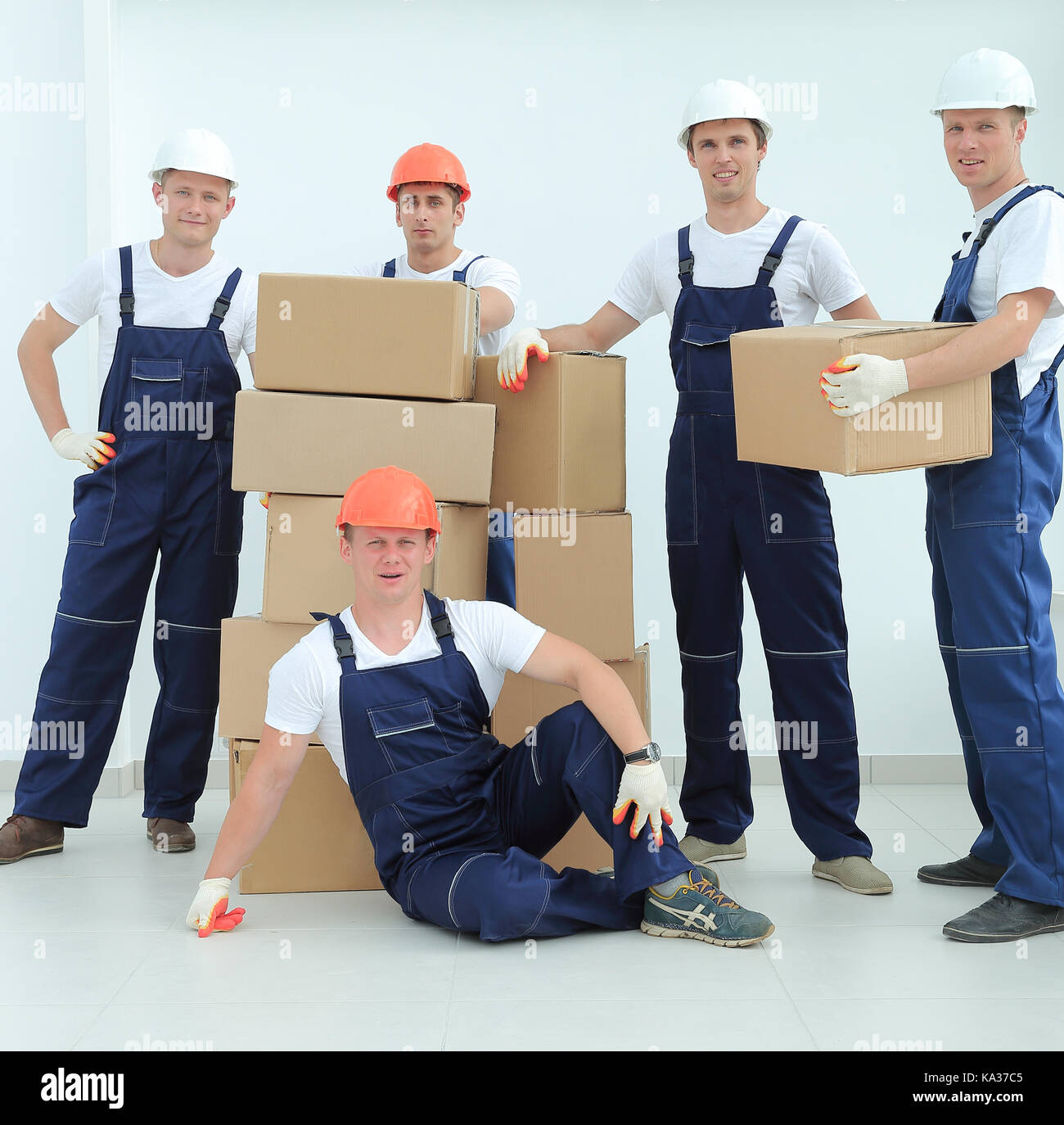 foreman and team builders with boxes - Stock Image