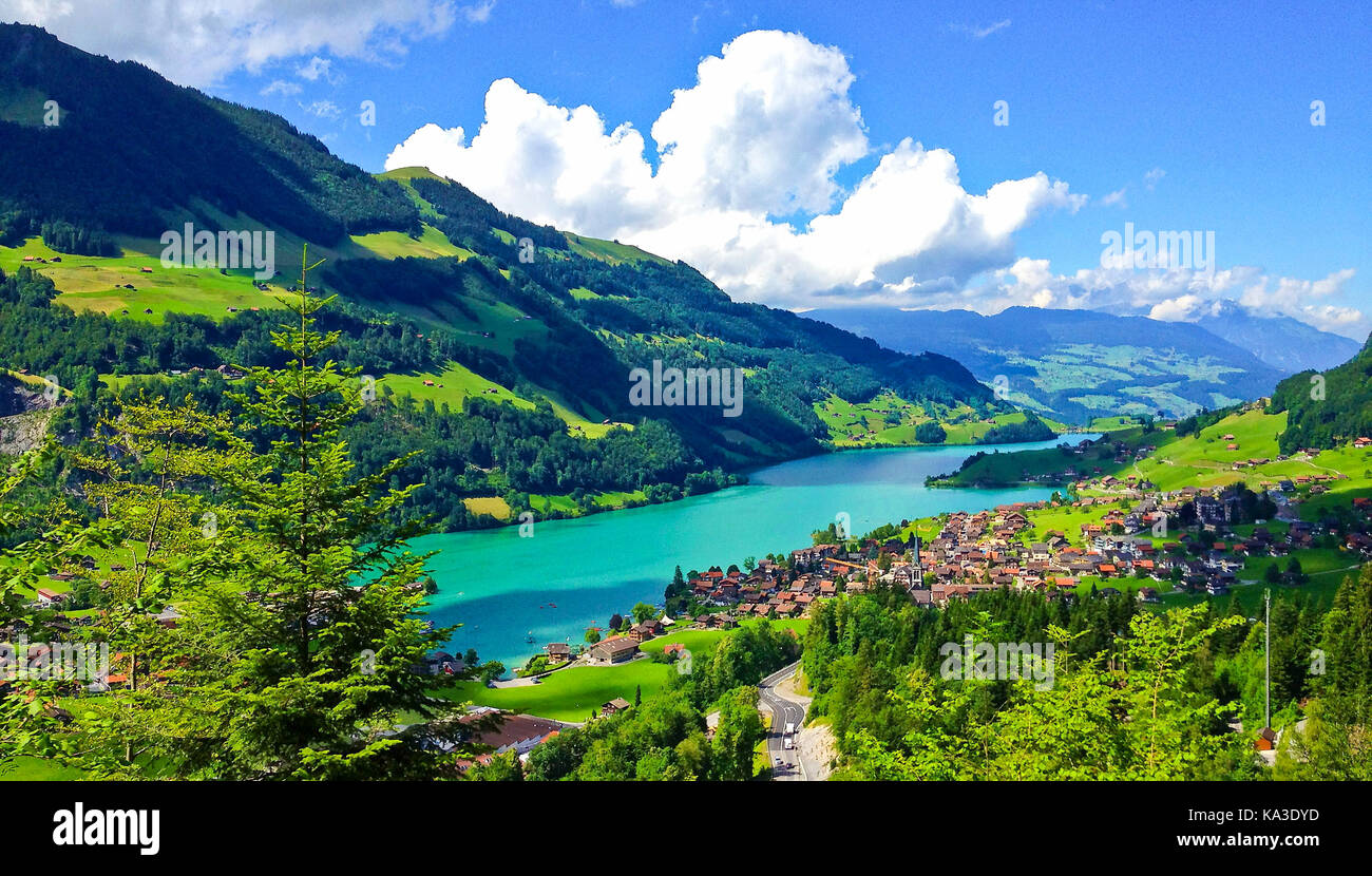 Rural Swiss Scenery from Train Ride Window View, Picturesque Picture as a Painting of Lungern Village and Lake in - Stock Image
