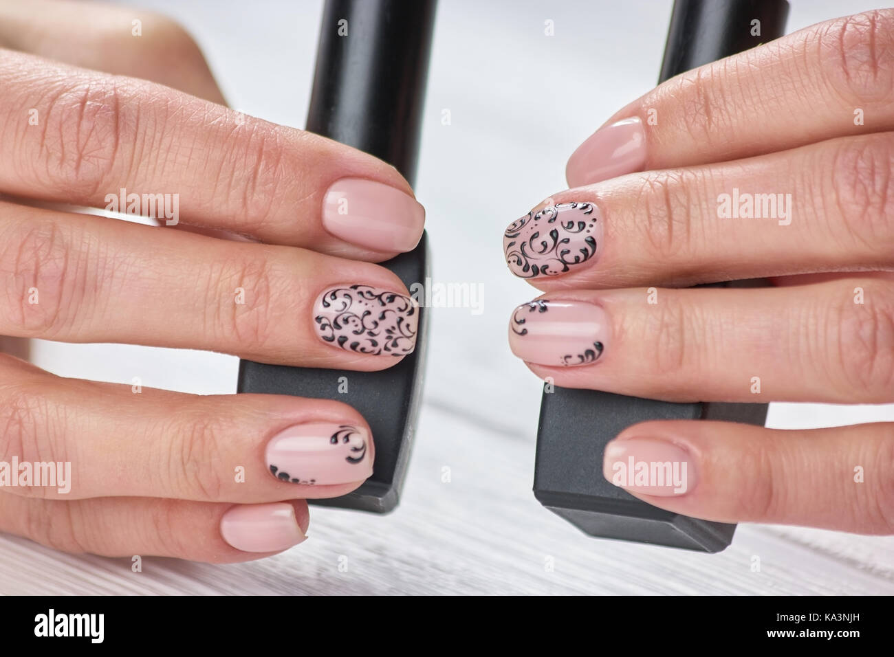 Perfect beige patterned manicure. Female manicured hands holding ...