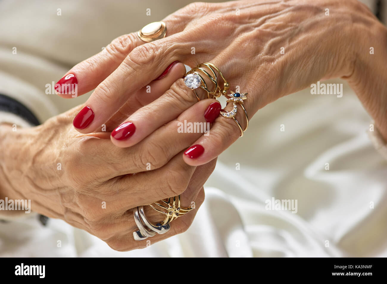 Female hands with golden rings. Senior woman hands with beautiful ...