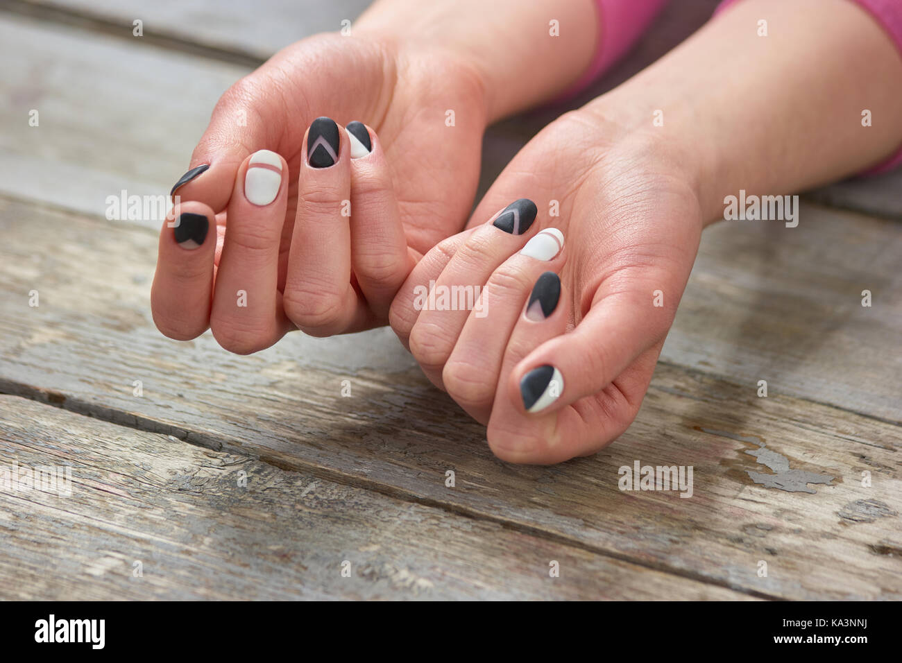 Female Manicured Hands On Wooden Background Woman With Black And White Matte Nails Old Vintage Nail Salon Spa