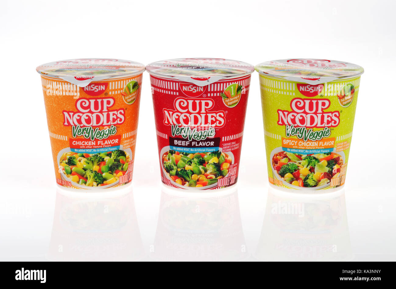 Variety of Nissin Cup of Noodles Very Veggie flavors chicken, spicy chicken and beef containers on white background. - Stock Image