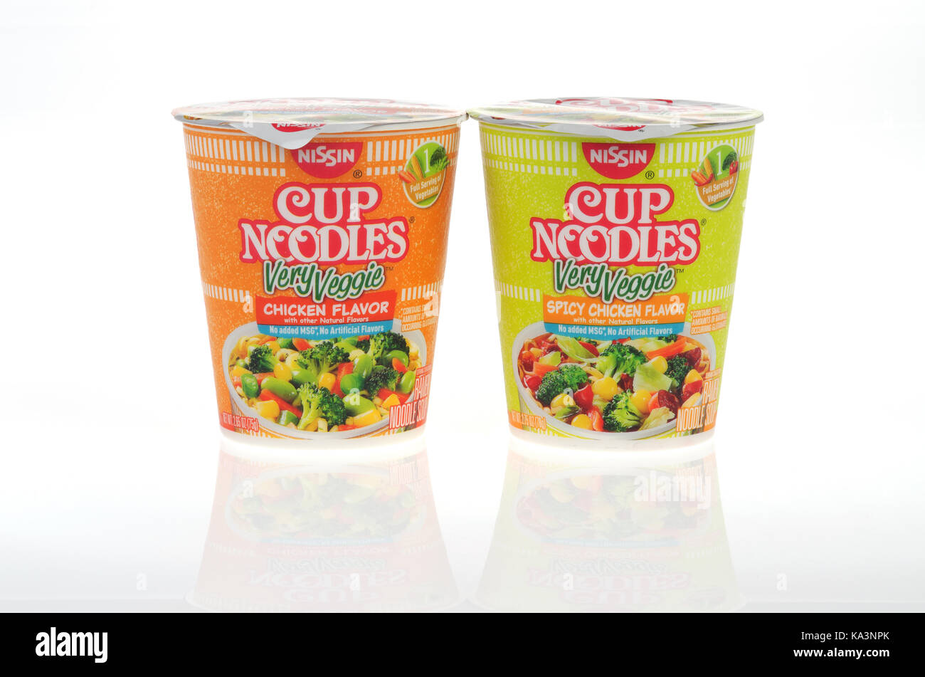 Unopened Nissin Cup of Noodles Very Veggie chicken flavor and spicy chicken flavor soups on whites background, cutout, - Stock Image