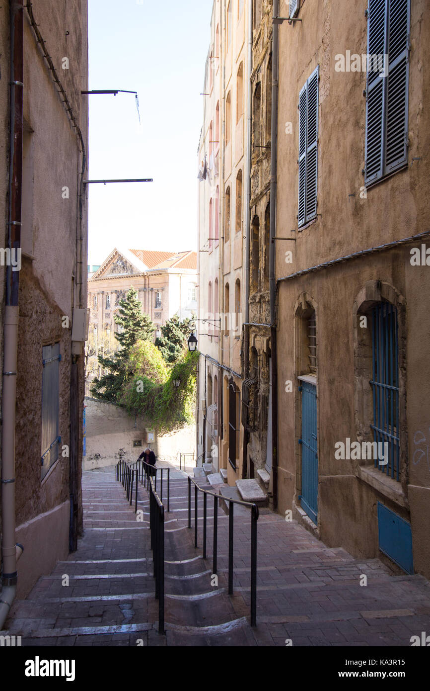 Pedestrian street in Marseille, France.  The steps and hand rails lead down into the lighted square. - Stock Image