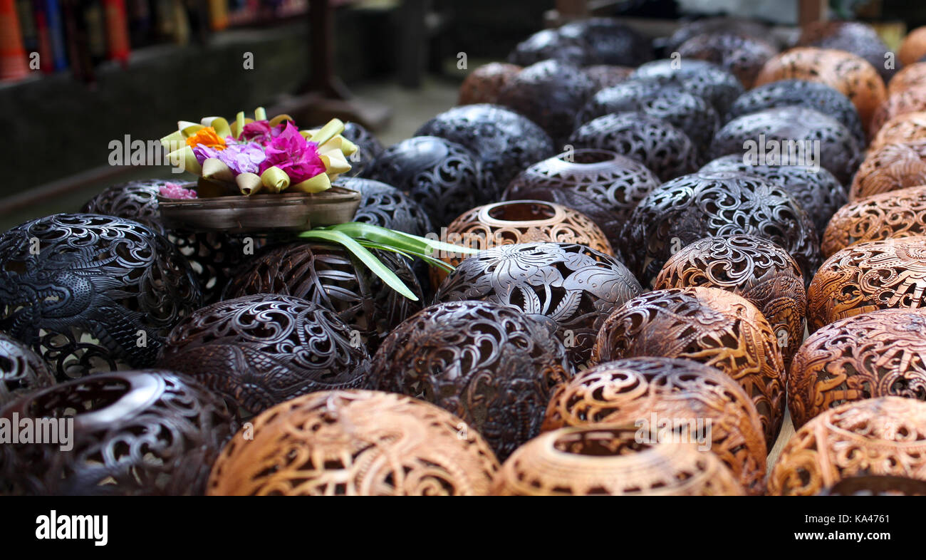 The offering for a better selling up on the lighters curved out from the coconuts, Bali Island, Indonesia - Stock Image