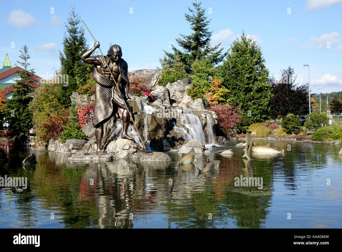 A sculpture of a Tulalip Indian sperarfishing for salmon. - Stock Image
