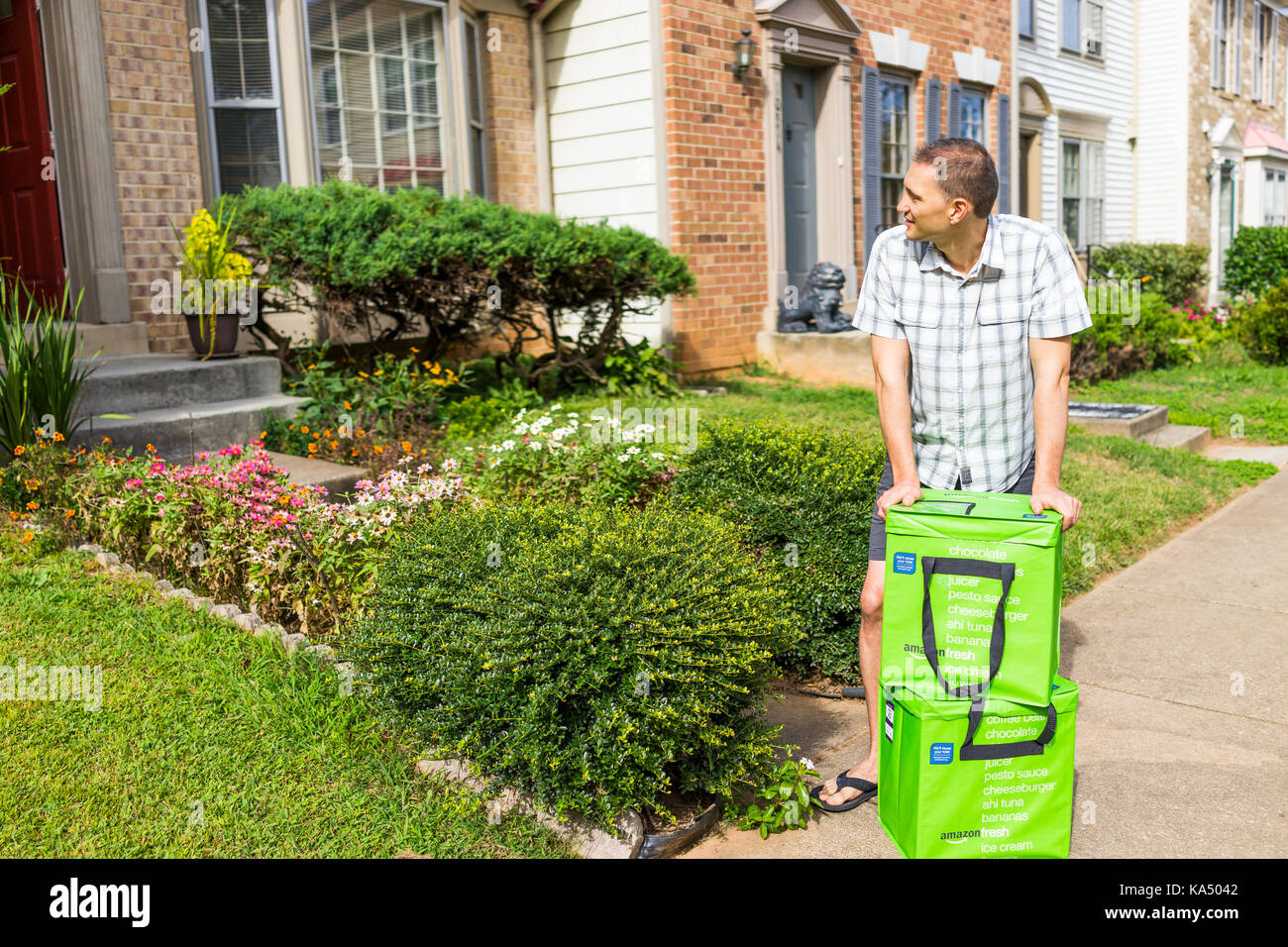 Fairfax, USA - September 12, 2017: Amazon Fresh insulated grocery delivery bags, totes on front home house porch - Stock Image