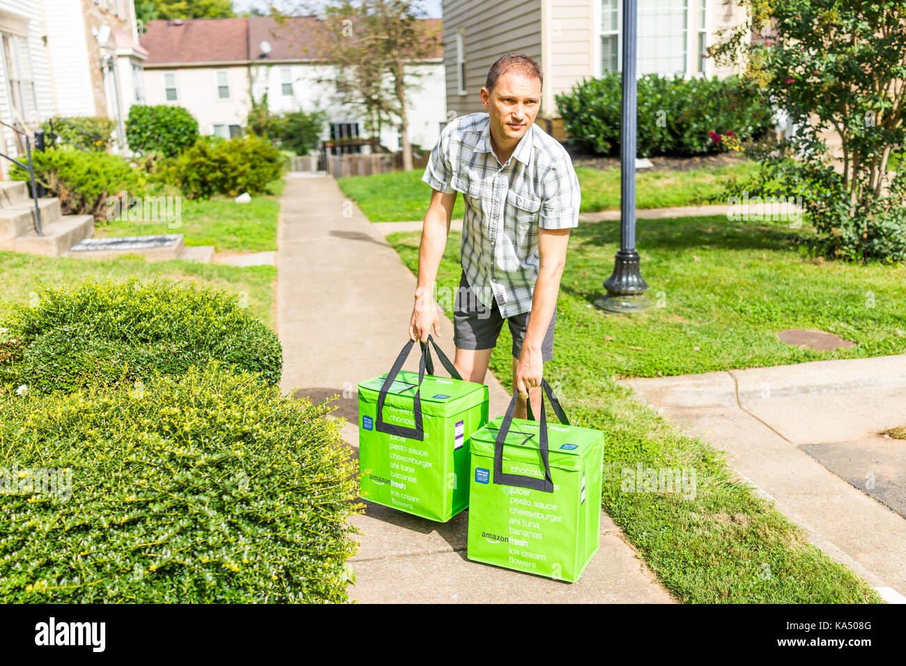 Fairfax, USA - September 12, 2017: Amazon Fresh insulated grocery delivery bags totes on front home house porch - Stock Image