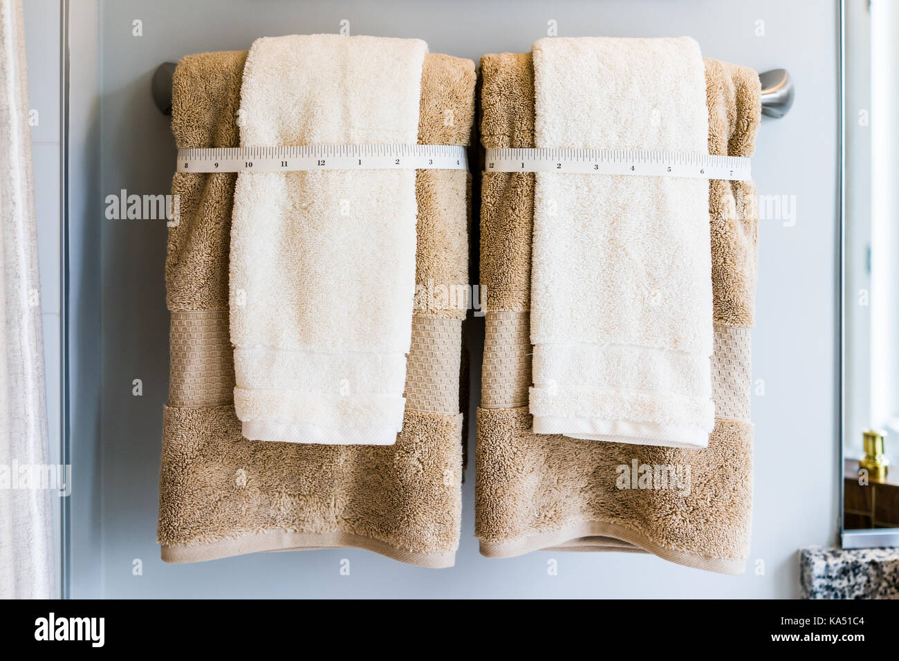 Staging modern bathroom with two decorated brown hand and body ...