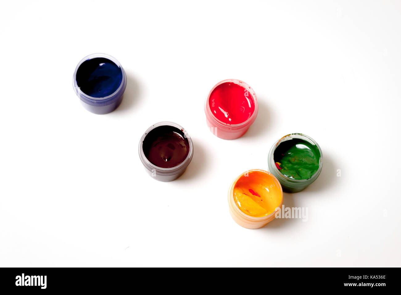 Color gouache jars on white background - Stock Image