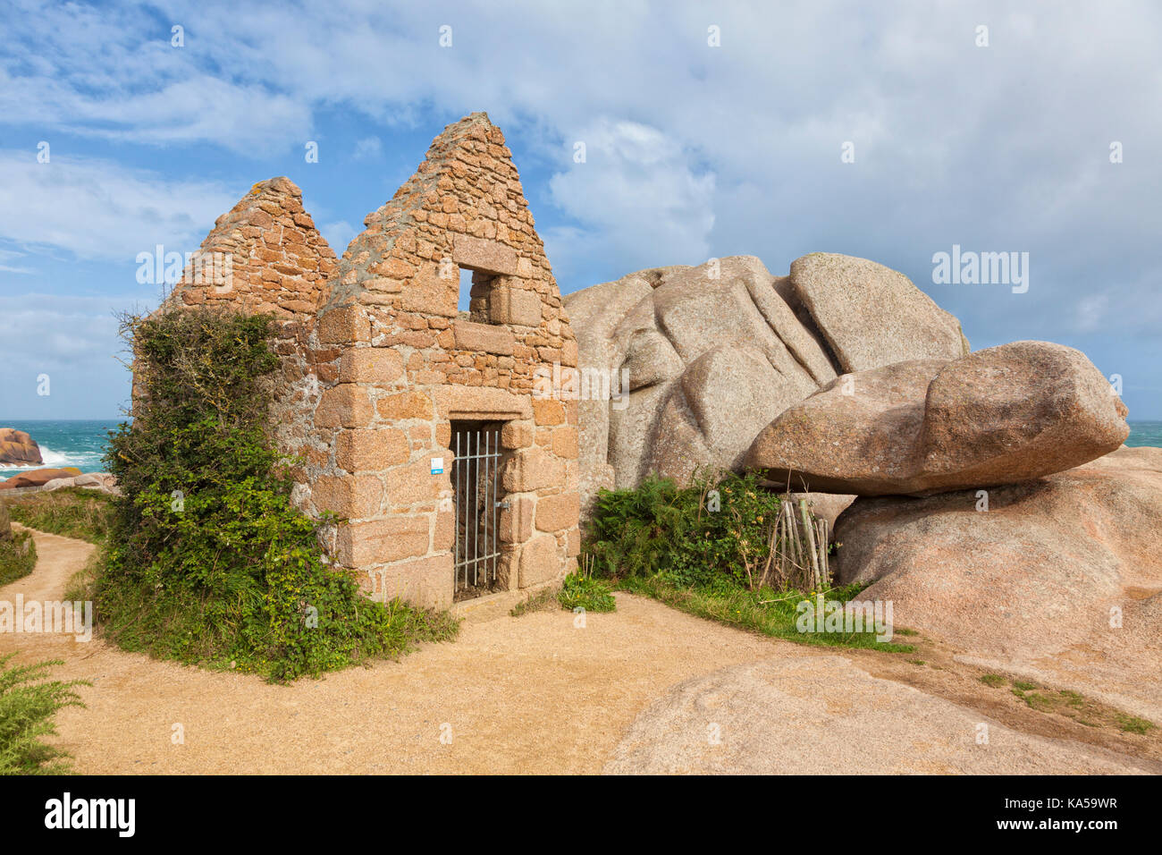 Ruins of the old gun powder store or Poudrière at Ploumanac'h site, Perros-Guirec, Brittany, France - Stock Image