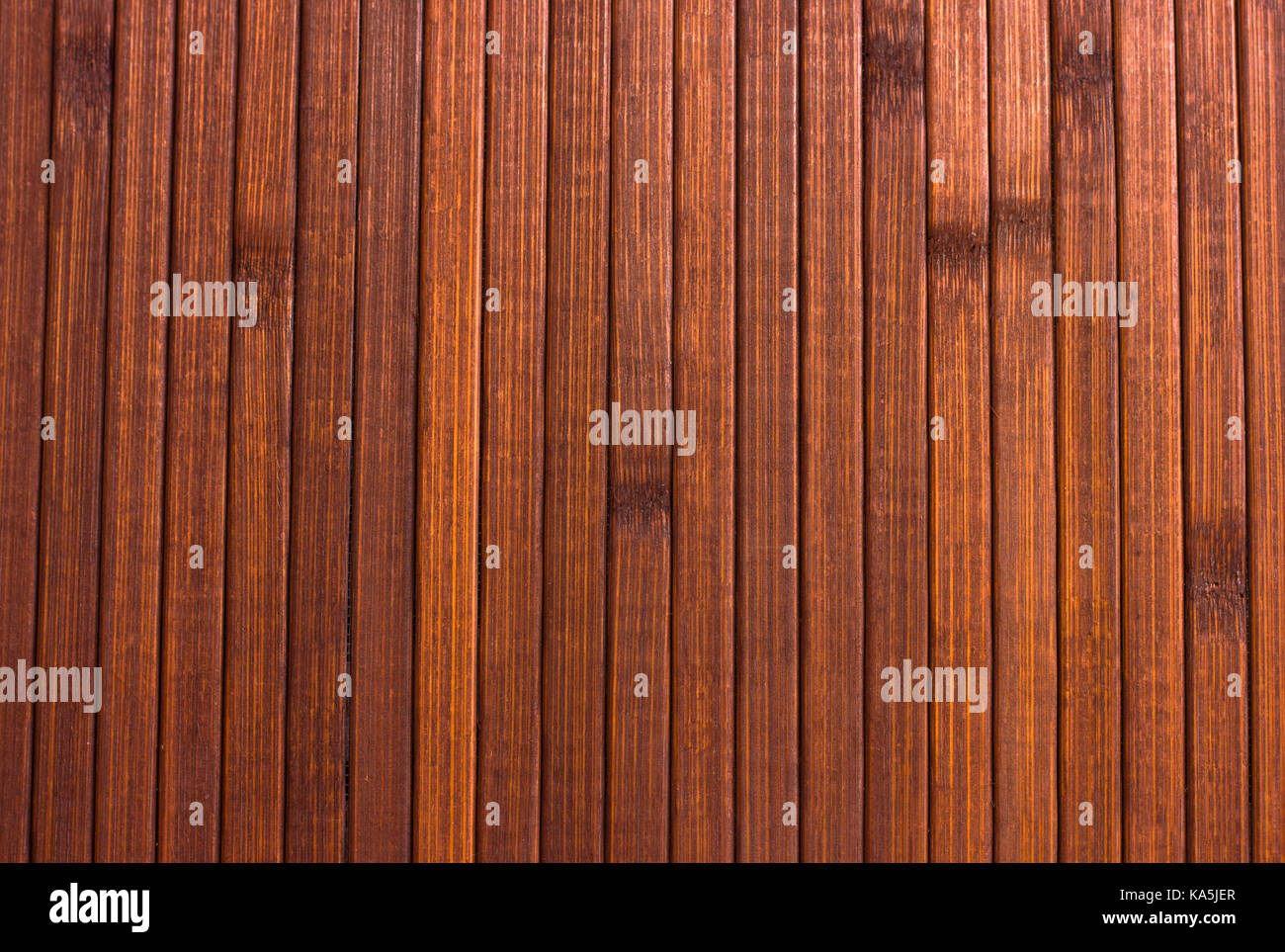 Wooden brown background. Smooth polished wood - Stock Image