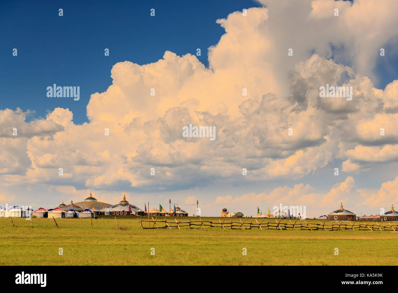 Mongolian traditional houses in immense grassland.They call these tents as ''Yurt'' - Stock Image