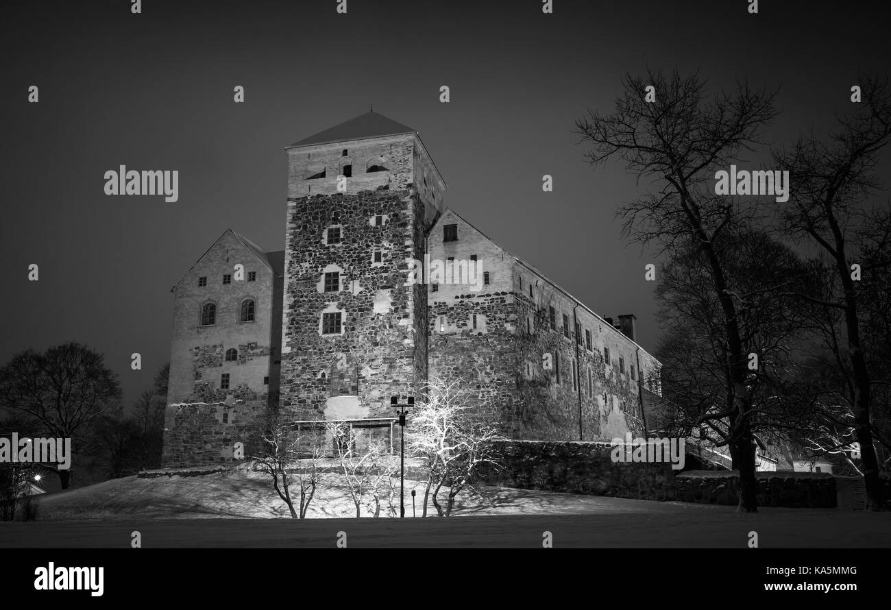 Black and white photo of Turku Castle at night, it is a medieval building in the city of Turku in Finland. It was - Stock Image