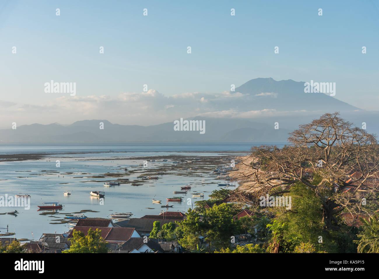 Beautiful view from Panorama point on the island Nusa Lembongan over Jungut Batu beach and the rumbling Vulcan Agung - Stock Image