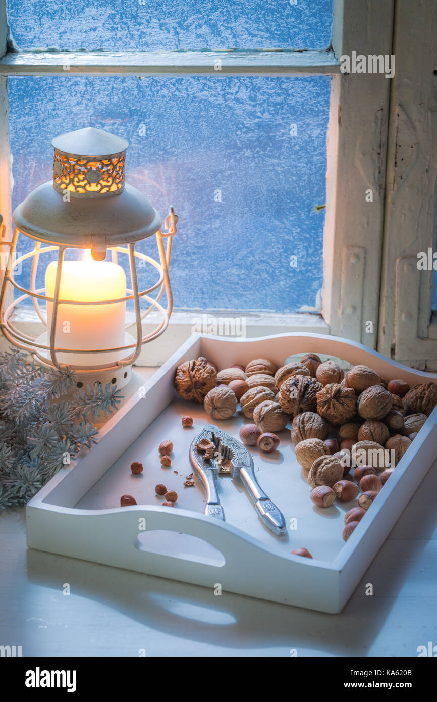 Nutcrackers and nuts for Christmas in cold evening - Stock Image