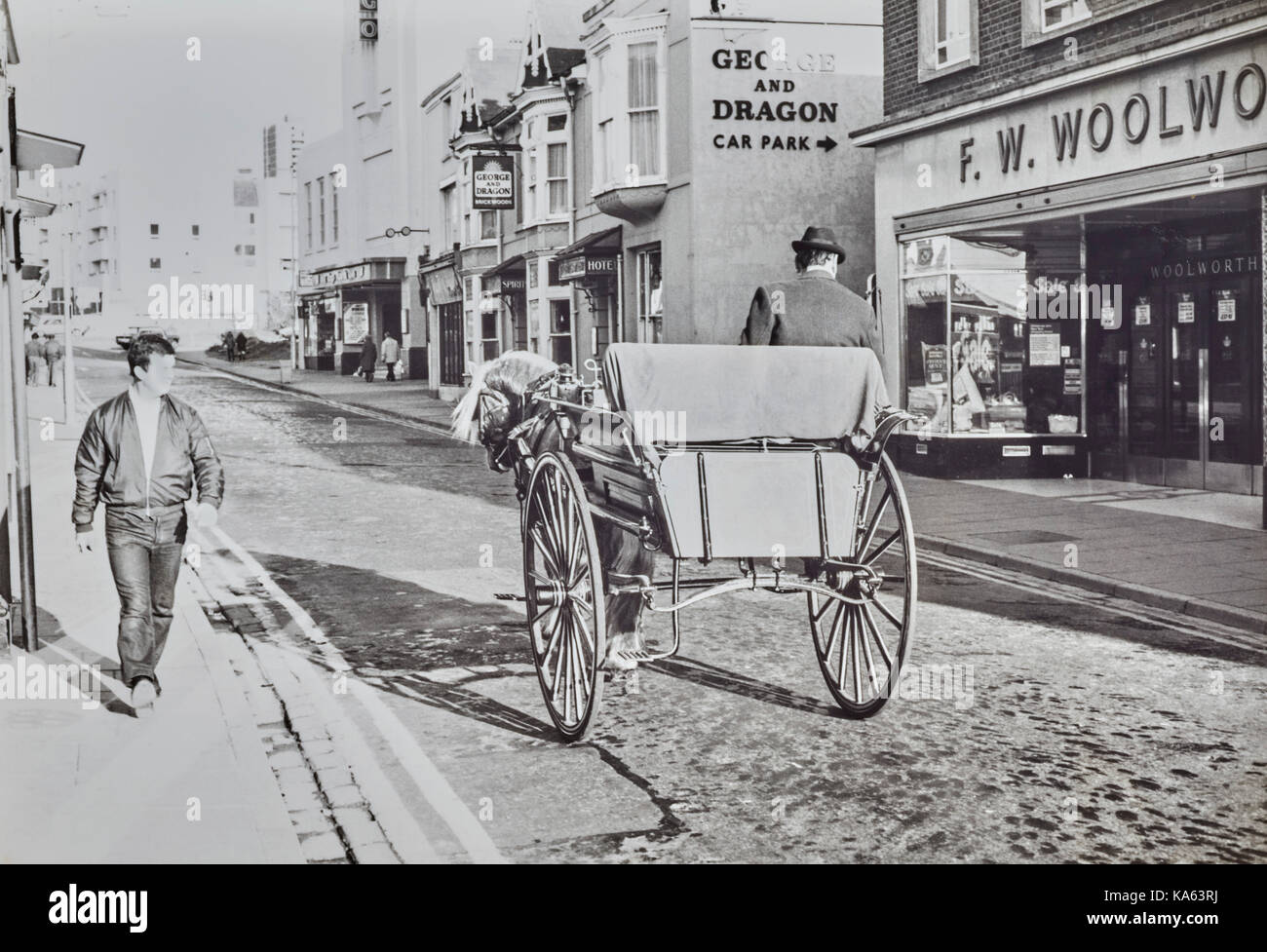 Man in dog cart in Cosham High Street 1981 Stock Photo