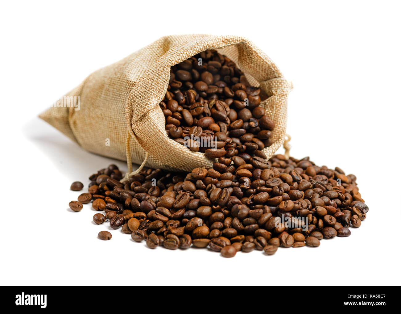 Coffee beans in jute sack  isolated on white background - Stock Image