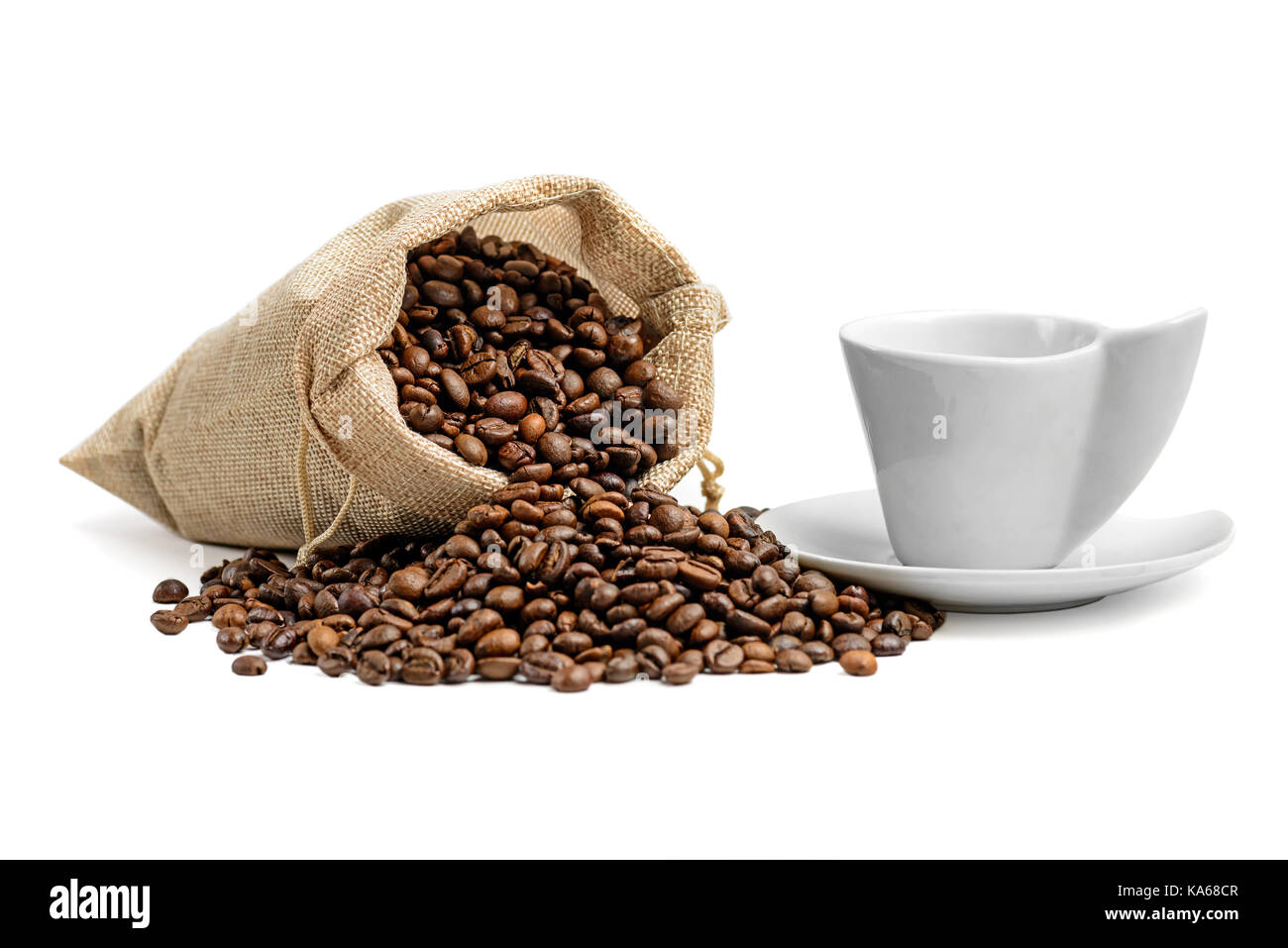 Coffee beans in jute sack  and  espresso cup isolated on white background - Stock Image