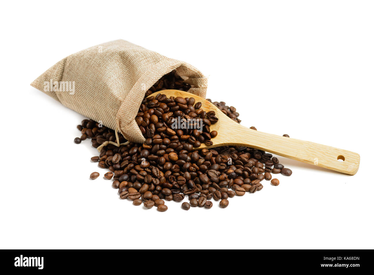 Coffee beans in jute sack  with wooden spoon isolated on white background - Stock Image