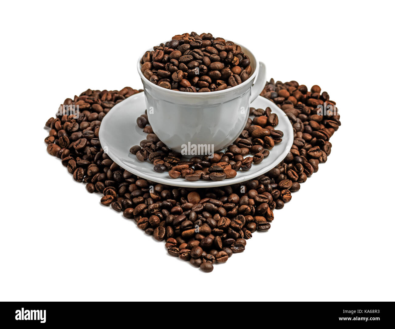 Coffee beans heart shape and  cup isolated on white background - Stock Image