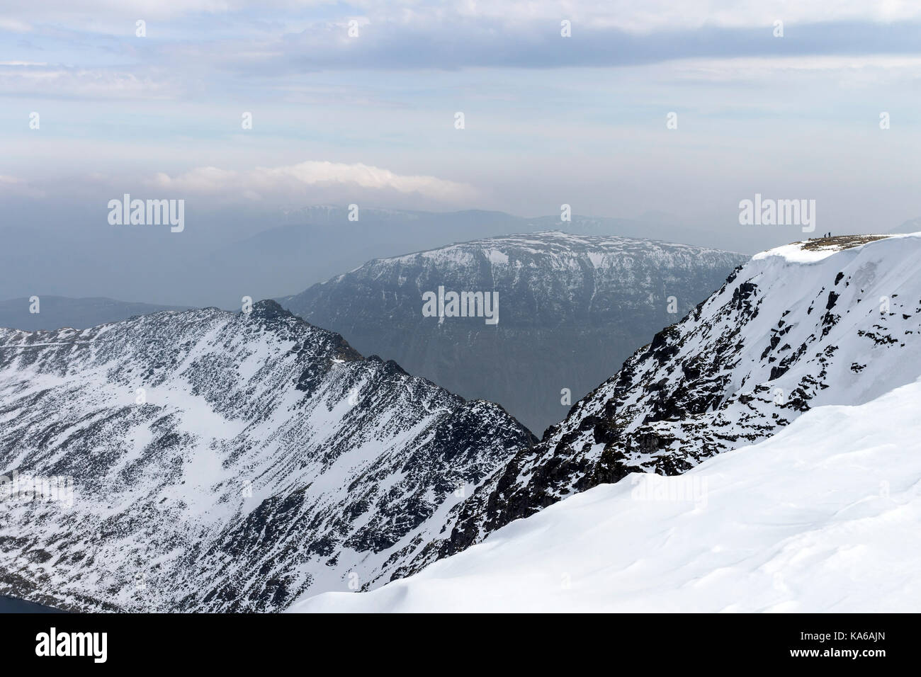 Stridding Edge from Helvellyn in Late Winter Conditions, Lake District, Cumbria, UK - Stock Image
