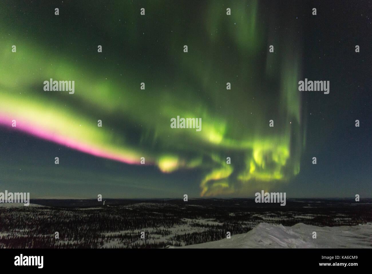 Northern light, Aurora borealis over winter landscape, Gällivare, Swedish Lapland, Sweden - Stock Image