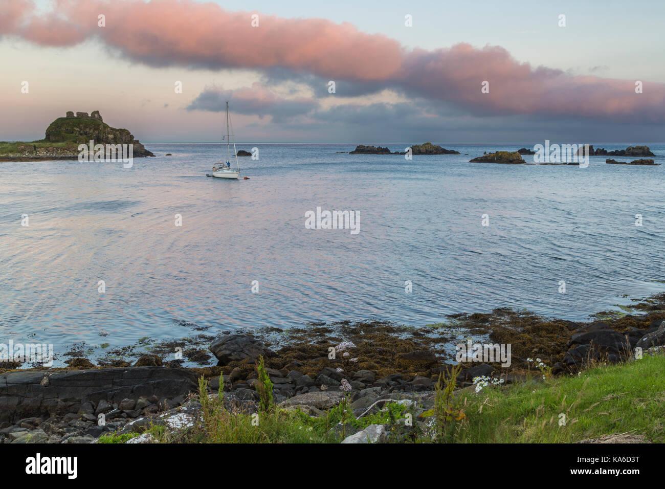 Sailing boat has droped anchor outside Islay, Scotland - Stock Image