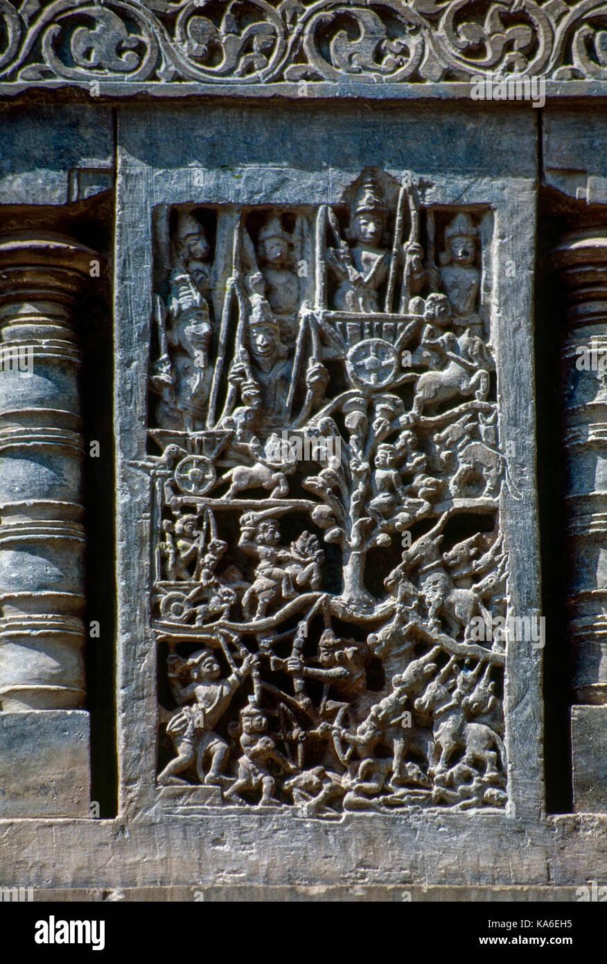 Mahabharata Battle scene relief on wall, Chennakesava temple, karnataka , India, Asia - Stock Image