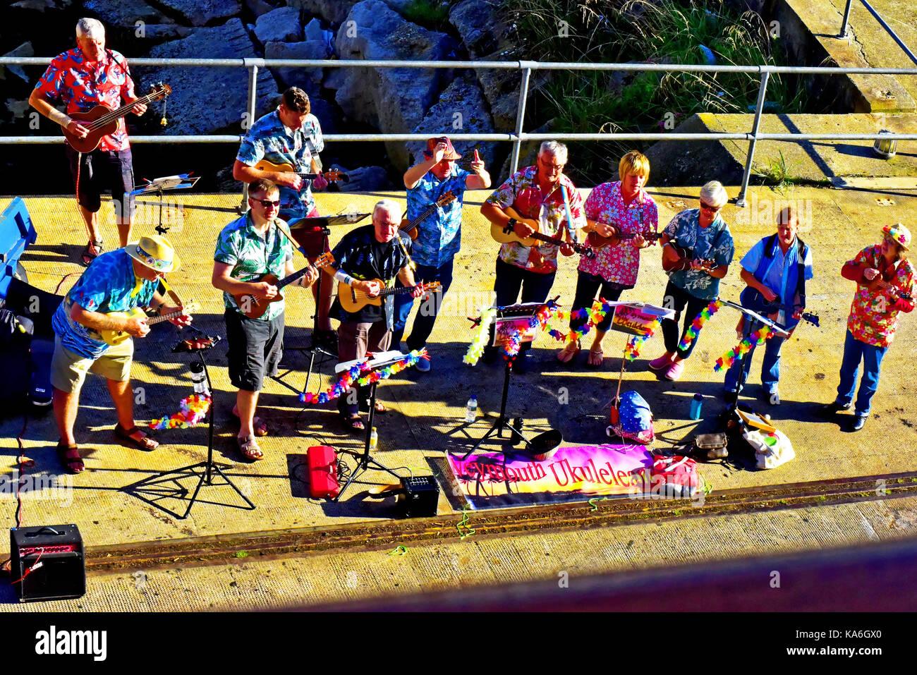 Portland Dorset Castletown Weymouth Ukuleans ukulele band sending off the cruise ship Balmoral - Stock Image
