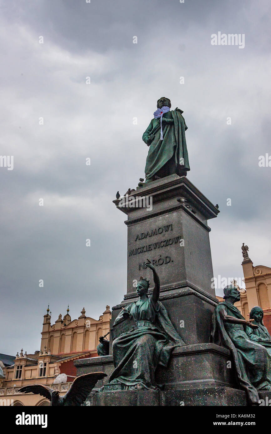 KRAKOW, POLAND - JUNE, 2012: Adam Mickiewicz Monument in square and people resting around it - Stock Image