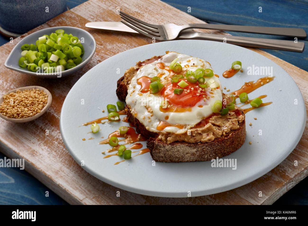 Honey sriracha fried egg on toast Stock Photo