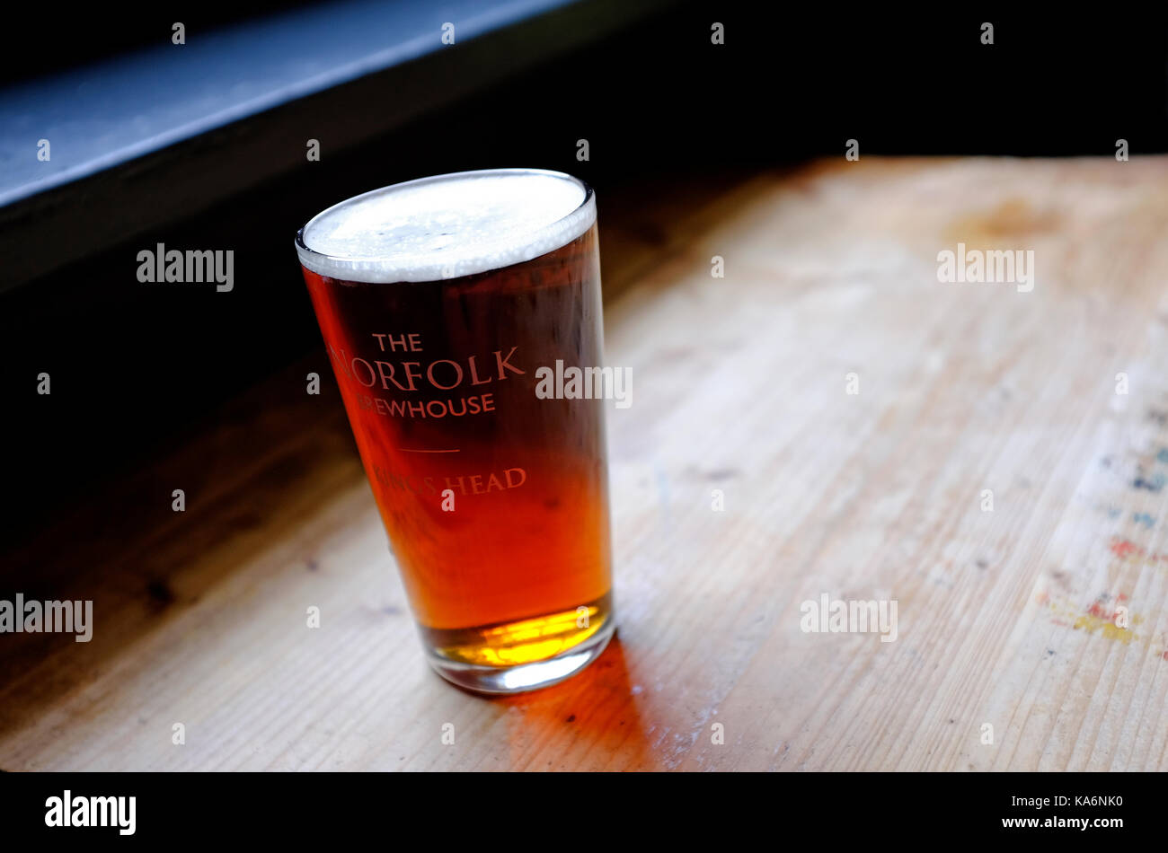 traditional norfolk beer in half pint glass - Stock Image