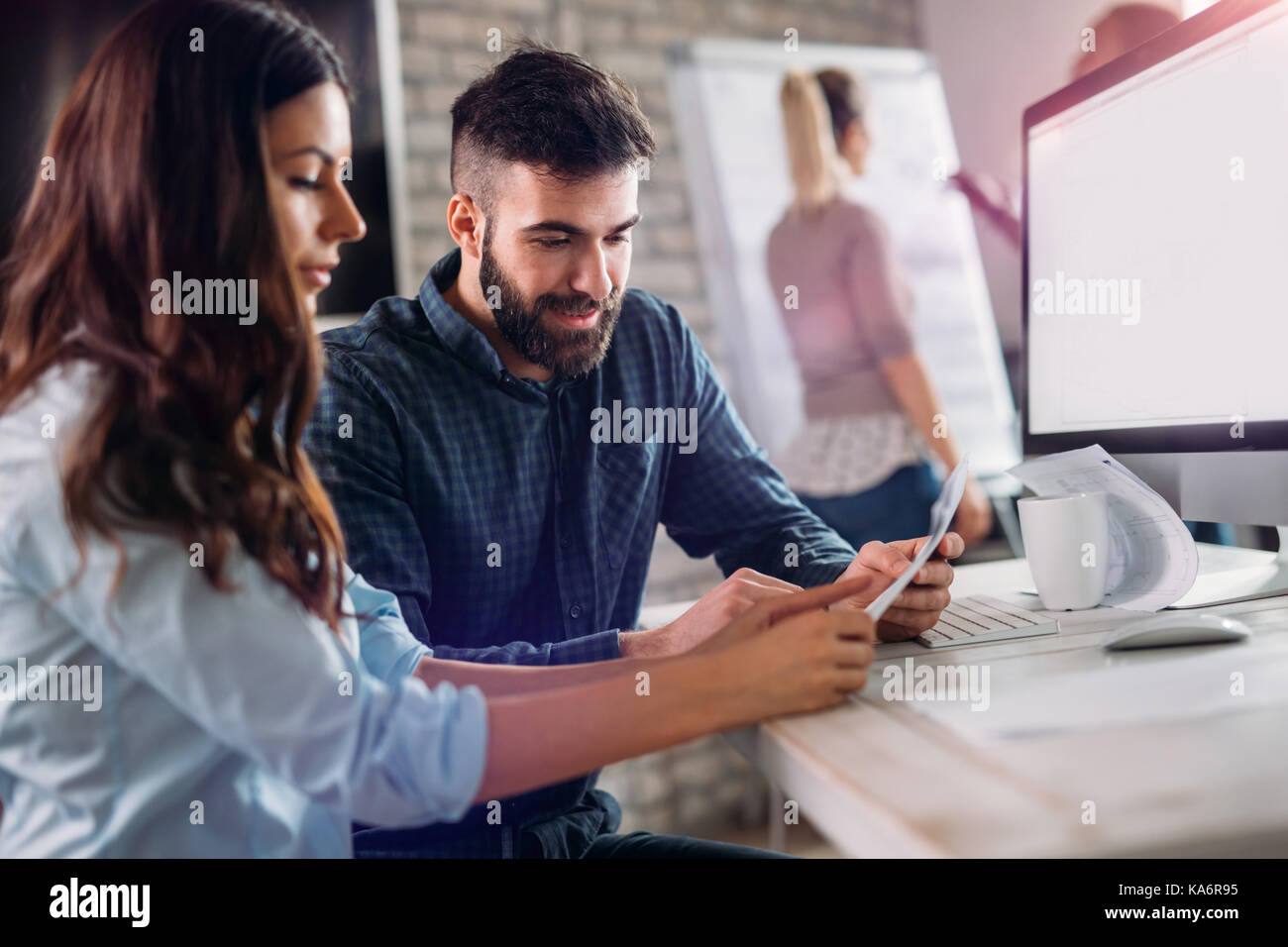 Coworking and corporate colleagues working in office - Stock Image
