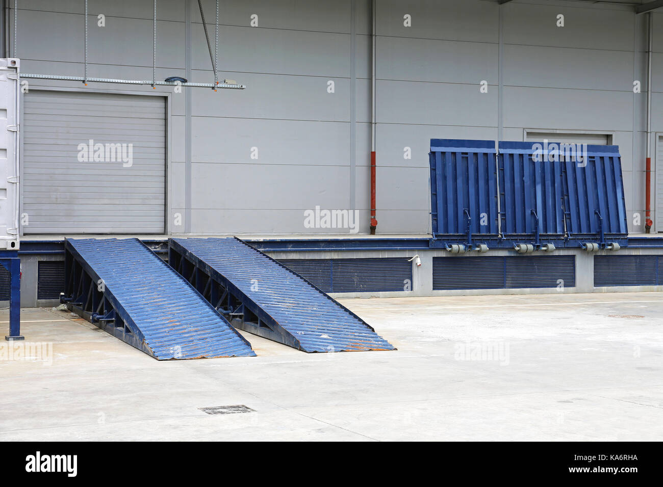 Dock Ramp and Door at Distribution Warehouse - Stock Image